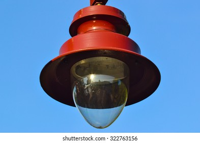 Vintage street lantern in front of blue sky