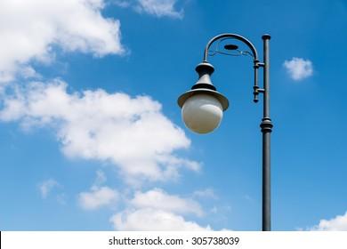vintage street light pole against blue sky ez canvas
