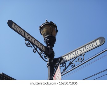 Vintage street sign and lamp post at the intersection of Washington Street and Second Street in Hoboken, New Jersey