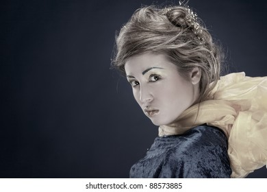 Vintage studio portrait of beautiful fashionable woman