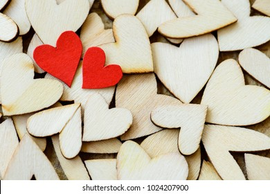 Vintage style of 2 red hearts with wooden hearts on a wooden background. Happy Valentine's Day concept.