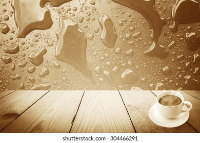 Vintage style - Abstract rain drops on a window or water drops on grass and coffee cup and wood background
