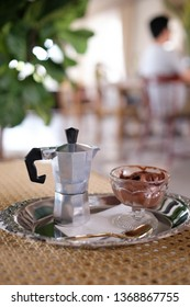 Vintage style : Affogato, Italian coffee-base dessert with chocolate ice cream topped with a short of hot coffee in mola express pot, golden spoon, art and craft mood