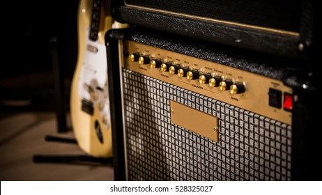 vintage style amp and guitar in the background.