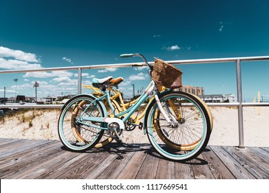 Vintage Style Bicycles Teal and Yellow on Ocean City New Jersey Boardwalk with Beautiful Blue Sky with some Clouds
