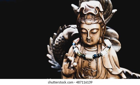 Vintage style of Buddha statue with light dark background . buddha image used as amulets of Buddhism religion.
