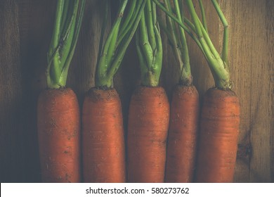 Vintage style carrots on wood