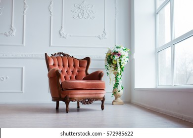 Vintage style chair in classical interior room with big window and flowers