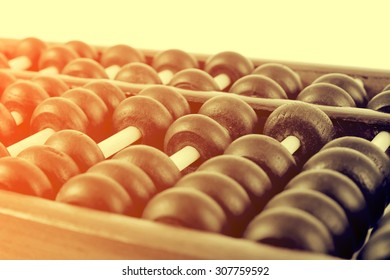 Vintage style - Close up of a wooden abacus beads. Selective focus, shallow depth of field. Wooden abacus