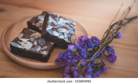 Vintage style closeup brownie with almond on wooden background wallpaper closeup one point shallow with depth of field