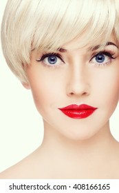 Vintage style close-up portrait of young beautiful blond girl with winged eye make-up and red lipstick