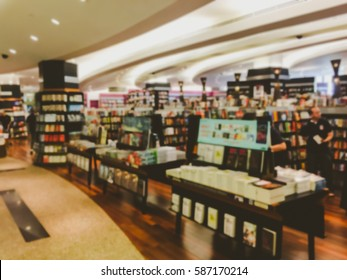 Vintage style color tone.Blur image of a bookstore .