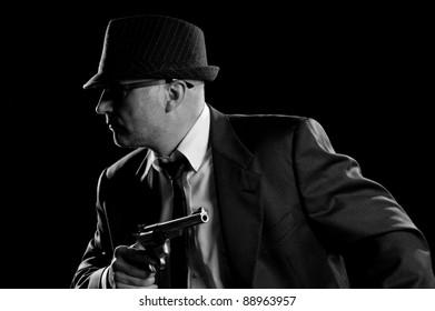 Vintage style Detective posing with Handgun
