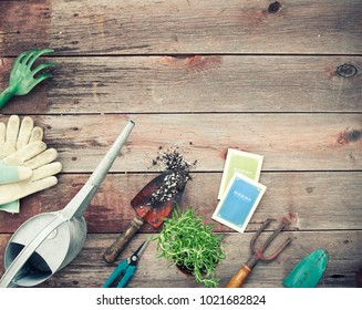 Vintage Style Gardening with Hand Shovel, Rakes, Soil/Dirt on an Old Wood Background (Seed Packets Created by Photographer in Photoshop)