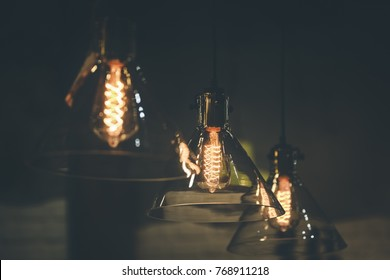 Vintage style glass lampshade with edison bulbs decorated in a living room ceiling.