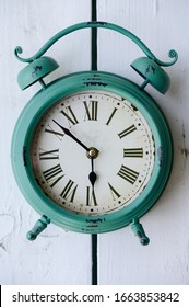 Vintage style green table clock on white color wood
