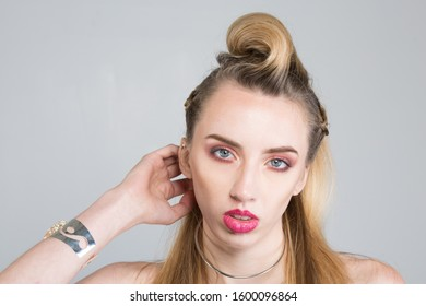 Vintage style image of blonde fashion model with full makeup and hair. Beautiful model concept image.