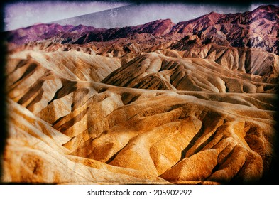 Vintage style image of Heavily Eroded Ridges At the famous Zabriskie Point, Death Valley National Park, California, USA