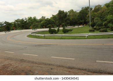 Vintage style image of a lonely snake curved road, Curved road on the mountain like a snake to the Sakon Nakhon province