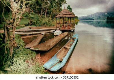 Vintage style image of traditional boats at Lake Bunyonyi in Uganda, Africa, at the borders of Uganda, Congo and Rwanda, not far from the Bwindi National Park, home of the last mountain gorillas
