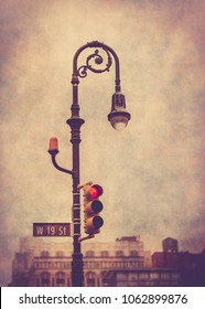 Vintage style lamp post and traffic light in New York City at 19th Street with retro grunge texture