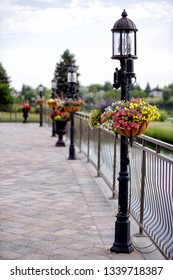 Vintage style lamp posts with hanging flower baskets.