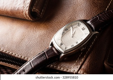 vintage style of luxury men watch with stainless case and leather strap