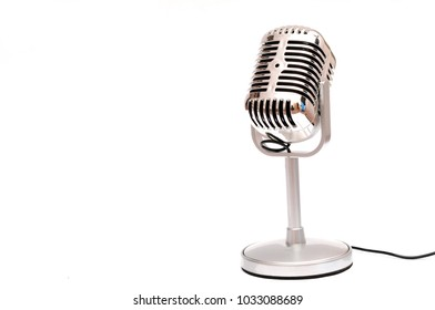 Vintage style microphone isolated on white background