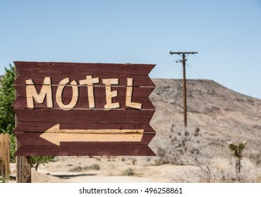 Vintage style motel sign direction in the mojave desert, California