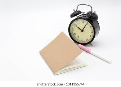 Vintage style of notebook, pen and clock on white background. Include path for selection, dicut work.
