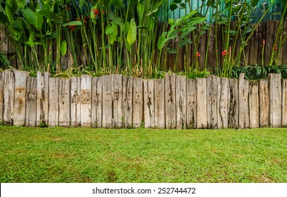 vintage style old wood fence made from Railway sleeper on garden background