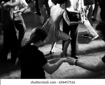 Vintage style photo of dance hall with people dancing
