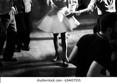 Vintage style photo of dance hall with people dancing in ballroom