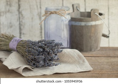 Vintage style photograph of dried lavender with a wooden bucket