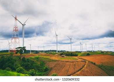 Vintage style photography of Wind power farm or group of wind turbines on the hill generate electric power.