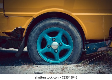 Vintage style picture of broken down car parking on the rough road with flat tire. In concept obstacles in life and journey,unmotivated and lazy. How to restore a car and keep a car in good condition.