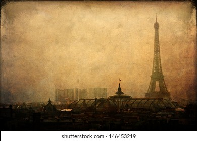 vintage style picture of the foggy city of Paris with Eiffel Tower
