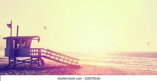 Vintage style picture of lifeguard tower at sunset in Malibu, USA.