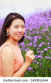 Vintage style portrait photography of pretty Asian girl in verbena flower park, selected focus.