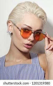 Vintage style portrait of young beautiful woman with stylish sunglasses