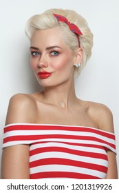 Vintage style portrait of young beautiful blond woman in striped top