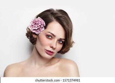 Vintage style portrait of young beautiful woman with clean makeup