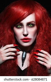 Vintage style portrait of young beautiful redhead woman with gothic Halloween make-up