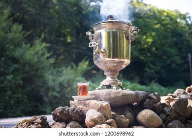 Vintage style samovar. Water poured into the samovar is heated by the fire burning. Picnic time
