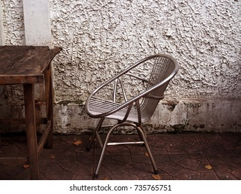 Vintage Style Shiny Wire Mesh See Through Chair, Side View, With Part Of Old