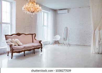 Vintage style sofa in loft interior room with big window.