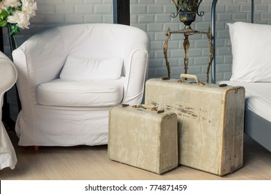 vintage style suitcase luggage earth tone color with texture in vintage interior room