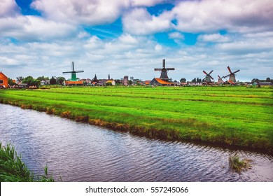 Vintage style of traditional Dutch Windmills and cottages in Zaanse Schans.