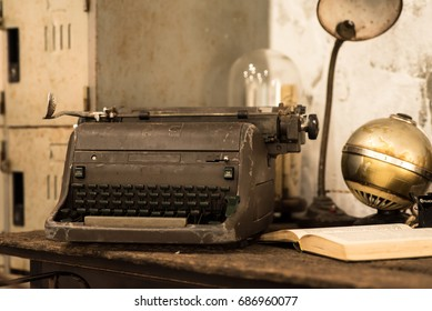 Vintage Style of  typewriter and old books on the desk
