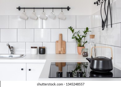 Vintage style white kitchen with black, stylish kettle